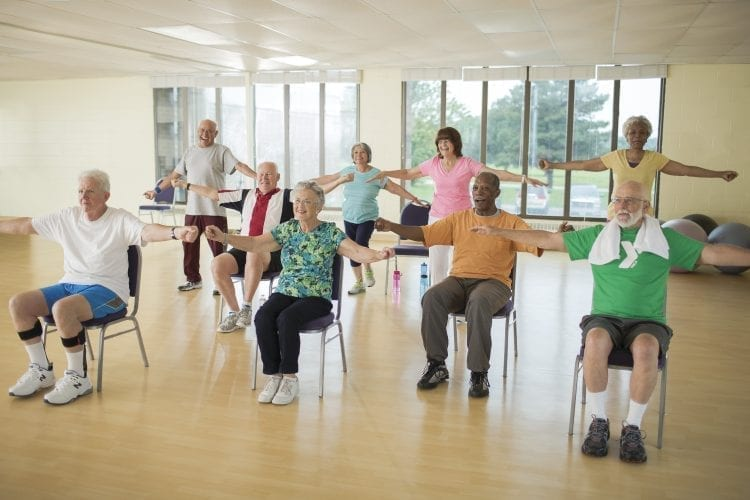 active older adults working out in group class