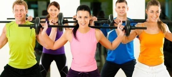 five people lifting weights together