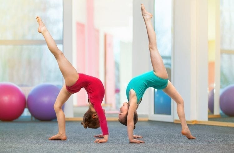 two girls doing gymnastics