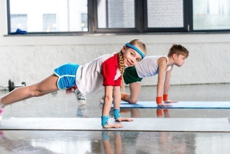 two kids working on fitness together
