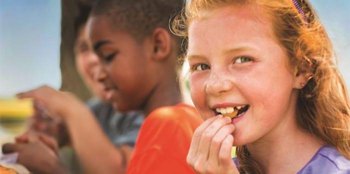 Meal Program - Young Girl Eating